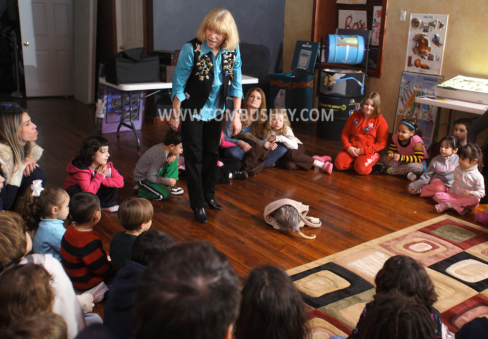 """Middletown, NY - Jan Berlin, director of Everything Animals Resource Center, shows an opossum to children and adults at the Interactive Museum during her program """"Live Animals from Around the World"""" on Feb. 7, 2010."""