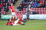 12 Eddie Nolan for Crewe Alexander challenges 8 Ollie Palmer for Lincoln City during the EFL Sky Bet League 2 match between Crewe Alexandra and Lincoln City at Alexandra Stadium, Crewe, England on 26 December 2018.