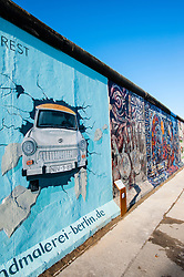 Painting of Trabant car breaking through wall at East Side Gallery at former Berlin Wall in Friedrichshain/Kreuzberg in Berlin Germany