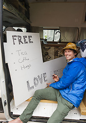 March 17, 2019 - Christchurch, Canterbury, New Zealand - Erin Allison-Maxwell of Auckland offers free tea, coffee and hugs to those grieving the shooting deaths of 50 people at two city mosques. Allison-Maxwell drove up in his camper van from Wanaka, saying he wanted to do something to help. (Credit Image: © PJ Heller/ZUMA Wire)