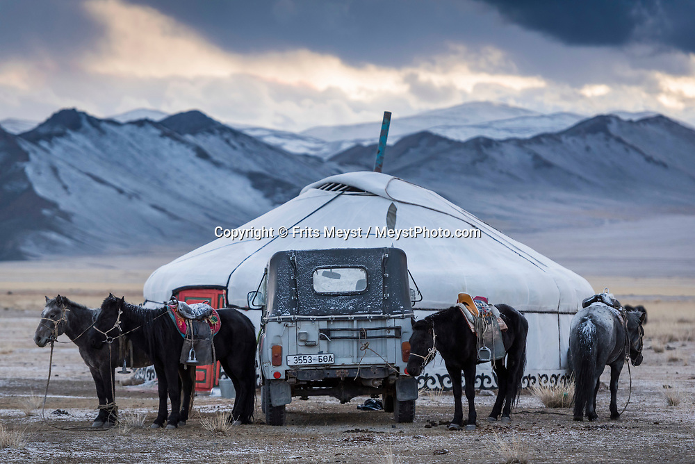 Ulgii, Altai Mountains, Mongolia, September 2017.  Winter has arrived in a yurt settlement on the steppes between the Altai mountains. For centuries, Kazakh men have hunted from horseback with trained golden eagles, the largest and most powerful of raptors. They hunt during winter, when the pelts of the rabbits, red fox and wolf are at their most luxuriant. The hunter is named kusbegi or berkutchi. It takes 5 years to train a golden eagle to hunt, and the skills are transferred from father to son. The Altai Mountains are situated in Western Mongolia on the border with Russia, Kazakhstan and China. Photo by Frits Meyst / MeystPhoto.com