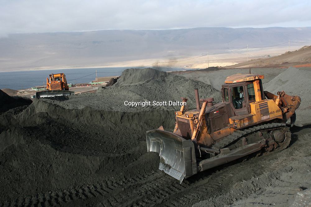 Tractors round up the minerals for export at San Nicolas, the port of the Shougang mine, a Chinese owned and operated mine, just outside of Marcona, in southern Peru, on October 25, 2007. (Photo/Scott Dalton)
