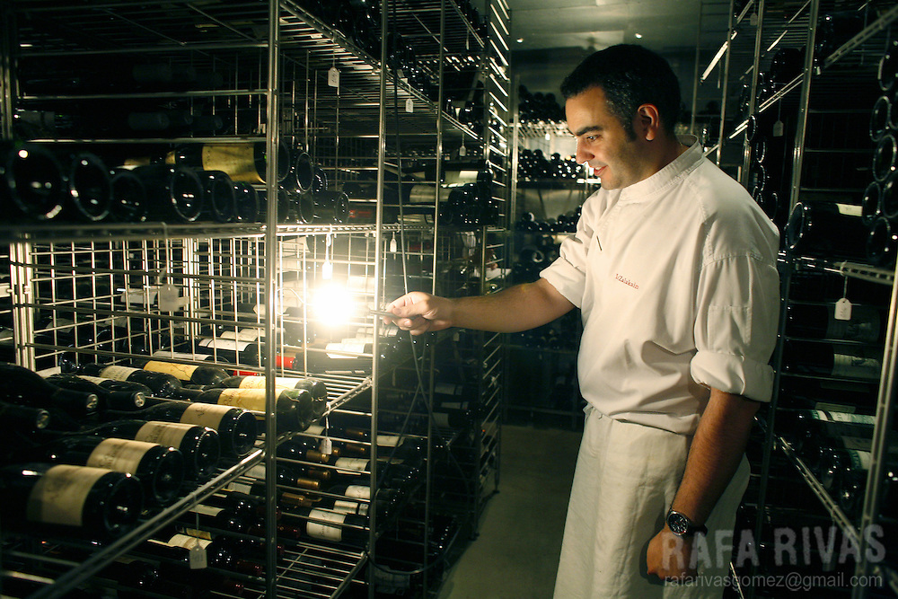 A cook shows the cellar of Spanish Basque top chef Juan Mari Arzak's restaurant, on July 03, 2008, in the northern Spanish Basque village of San Sebastian.
