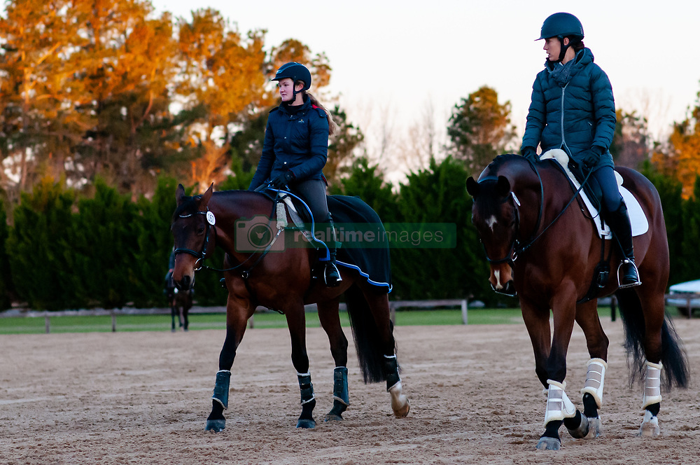 March 22, 2019 - Raeford, North Carolina, US - March 23, 2019 - Raeford, N.C., USA - Riders exercise their horses in the dressage warm-up ring at the sixth annual Cloud 11-Gavilan North LLC Carolina International CCI and Horse Trial, at Carolina Horse Park. The Carolina International CCI and Horse Trial is one of North AmericaÃ•s premier eventing competitions for national and international eventing combinations, hosting International competition at the CCI2*-S through CCI4*-S levels and National levels of Training through Advanced. (Credit Image: © Timothy L. Hale/ZUMA Wire)