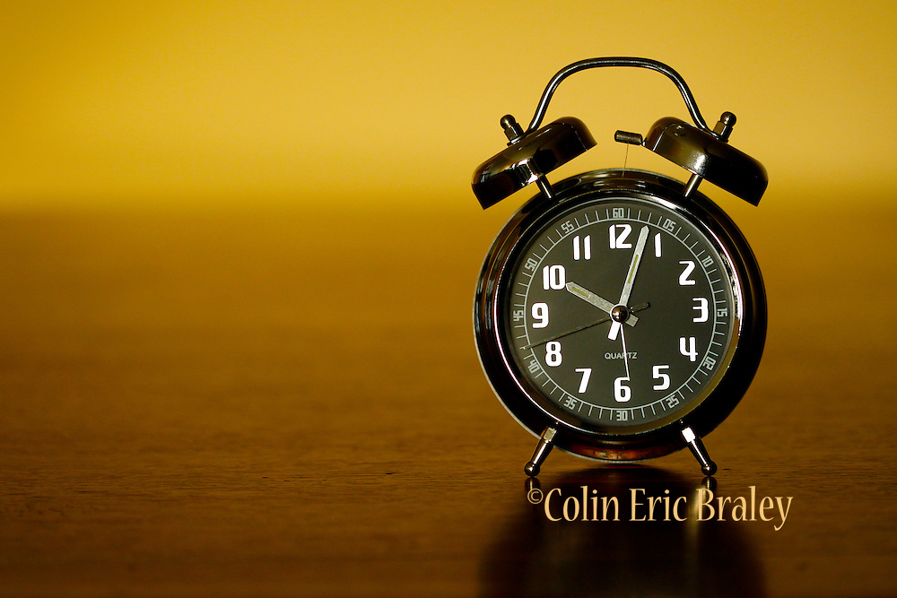 Antique styled alarm clock photographs for clock, time, daylight savings or other illustration. Colin E Braley (Wild West-Media)