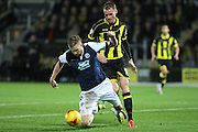 Millwall FC defender Mark Beevers and Burton Albion midfielder Tom Naylor challenge for the ball during the Sky Bet League 1 match between Burton Albion and Millwall at the Pirelli Stadium, Burton upon Trent, England on 1 December 2015. Photo by Aaron Lupton.