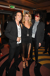 Left to right, STEPHEN & ASSIA WEBSTER and JOHN COOPER CLARKE at a party to launch a new collection of jewellery by Stephen Webster for De Beers entitles 'Burning Rocks' held at The Bloomsbury Ballroom, Bloomsbury Square, London WC1 on 26th June 2007.<br />