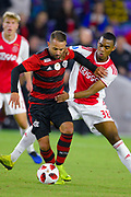 Ajax midefielder Ryan Gravenberch (38) and Flamengo midfielder Everton Ribeiro (7) in action during a Florida Cup match at Orlando City Stadium on Jan. 10, 2019 in Orlando, Florida. <br /> Flamengo won in penalties 4-3.<br /> <br /> ©2019 Scott A. Miller