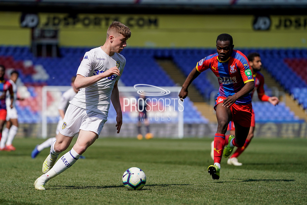 Jack Clarke of Leeds United U23 on the attack during the U23 Professional Development League match between U23 Crystal Palace and Leeds United at Selhurst Park, London, England on 15 April 2019.