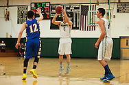 Winooski's Brandon Bigelow (5) takes a three point shot during the boys basketball game between the Milton Yellowjackets and the Winooski Spartans at Winooski High School on Tuesday evening December 29, 2015 in Winooski. (BRIAN JENKINS/for the FREE PRESS)