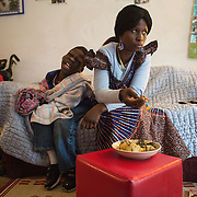 "Atlanta, Georgia/Central Africa Republic Refugee/Nestorine Lakas, 27, feeds her son Eric who has cerebral palsy, at their apartment in Atlanta. Nestorine arrived in the U.S. in 2010 with her two young children from the Central African Republic. Her son, who is now 7-years-old, suffers from severe cerebral palsy and requires a wheelchair and specialized healthcare. At the IRC in Atlanta, Nestorine is part of the Temporary Assistance for Needy Families (TANF) program where she is learning English, job skills and basic computer literacy so she can support her family as a single mom and learn how to manage her son's health needs. Unfortunately the father of Nestorine's children was not able to come to the U.S. with her, so she cares for her children and dreams of reuniting with him someday. Nestorine believes what makes her successful is ?working hard and overcoming challenges?. ""There was a war in my country and I fled to Cameroon. I was pregnant with my older son and gave birth along the way. When I fled I was alone. When I got to the camp I found my husbands name on a sign at the camp and we were reunited. My daughter Carol was born in Cameroon."" Because of her son's disability Nestorine got a humanitarian visa with the help of UNHCR. ""I am very happy to be here because they helped me a lot with my child. If I had stayed in CAR there isn't the healthcare that I have here. I am very thankful. The reason my child is still alive because I came as a refugee. Maybe the child would not have had any hope to walk. I hope one day he might walk.""."