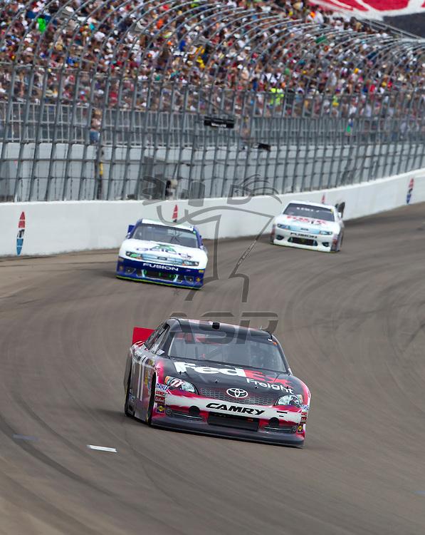 LAS VEGAS, NV - MAR 11, 2012:  Denny Hamlin (11) brings his car through the turns during the Kobalt Tools 400 race at the Las Vegas Motor Speedway in Las Vegas, NV.