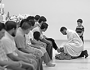 Priest washes the feet of the men and boys during a service at an Hispanic Catholic church in Charlotte, NC.