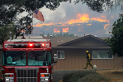 July 6, 2018 - Alpine, California, U.S. - A home burns near Olive View Road on Friday during a fire in Alpine amid a dangerous heat wave. A fast-moving brush fire in Alpine burned 400 acres, destroyed several structures and prompted evacuations. (Credit Image: © Eduardo Contreras/San Diego Union-Tribune via ZUMA Wire)
