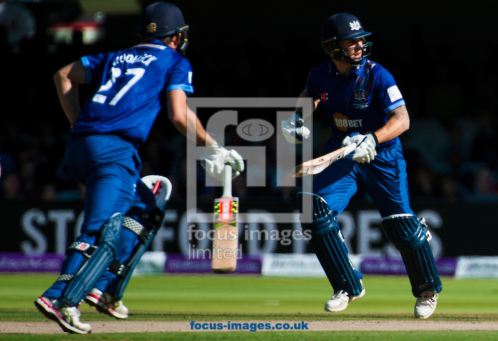 Joe Dent of Gloucestershire and Gareth Roderick run during the Royal London One Day Cup Final match at Lord's, London<br /> Picture by Jack Megaw/Focus Images Ltd +44 7481 764811<br /> 19/09/2015