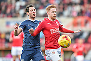 Swindon Town Defender, James Brophy (11) and Southend United Midfielder, Will Atkinson (12) battle for the ball during the EFL Sky Bet League 1 match between Swindon Town and Southend United at the County Ground, Swindon, England on 2 January 2017. Photo by Adam Rivers.