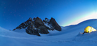 A panoramic view on a base camp on Col du Midi with the south face of Aiguille du Midi visible in the faint morning light. Photograph taken in Chamonix, Mont Blanc, France.