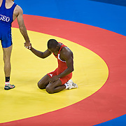 Otar Tushishvili of Georgia, left, shook the hand of Cuban wrestler Geandry Garzon, right, after Garzon lost to Tushishvili in the men's 66kg bronze medal match at the China Agricultural University Gymnasium on August 20, 2008 during the 2008 Summer Olympic Games in Beijing, China. (Photo by David Eulitt/The Kansas City Star/MCT)