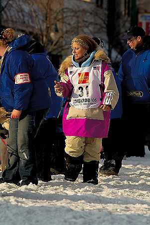 04 March 2006: Anchorage, Alaska - Fan favorite and cancer survivor, DeeDee Jonrowe of Willow, AK checks her team prior to the Ceremonial Start in downtown Anchorage of the 2006 Iditarod Sled Dog Race.
