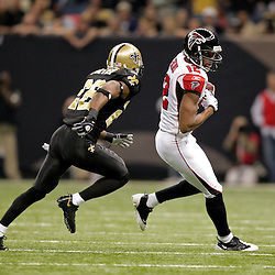 2009 November 02: Atlanta Falcons wide receiver Michael Jenkins (12) runs after a catch away from New Orleans Saints cornerback Tracy Porter (22) during the first half at the Louisiana Superdome in New Orleans, Louisiana.