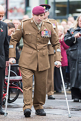 "© Licensed to London News Pictures. 08/11/2015. Doncaster, UK. Ben Parkinson, Britain's most badly injured surviving soldier at Remembrance Sunday in Doncaster wearing his full size Army uniform for the first time after getting new full-size prosthetic legs. Ben has now been restored to his full height with a pair of X3 Geniums prosthetic legs, which are taller than the ones he had previously and have ""intelligent technology"". Former paratrooper Ben Parkinson, 30, was wounded when the vehicle in which he was travelling hit a mine in Helmand Province, Afghanistan, in 2006. Ben suffered the loss of both of his legs, severe brain injuries and a broken spine in the blast.  Photo credit: Andrew McCaren/LNP"