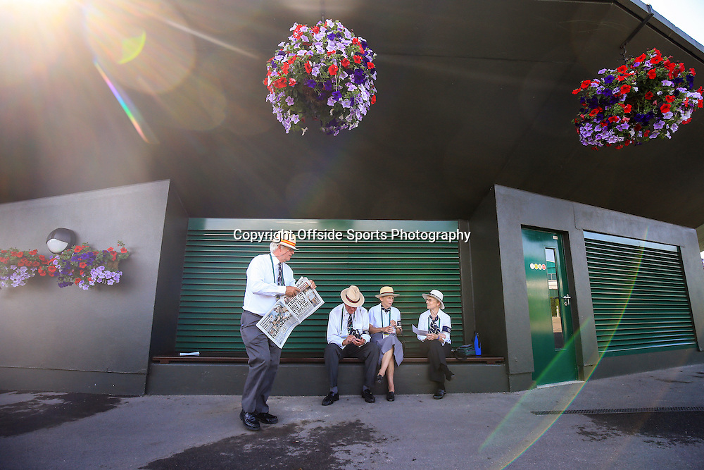 1 July 2015 - Wimbledon Tennis (Day 3) - A group of honorary stewards take a break in the shade as temperatures rise - Photo: Marc Atkins / Offside.