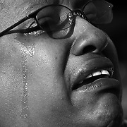 "A spectator cries, reacting while watching the inauguration ceremony of Barack Obama on jumbotron screens on the National Mall, January 20, 2009. Obama took the oath as the nation's 44th, and first African-American, President.     ltqmb   ""Faces 3"""