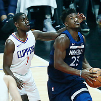06 December 2017: Minnesota Timberwolves guard Jimmy Butler (23) drives past LA Clippers guard Jawun Evans (1) during the Minnesota Timberwolves 113-107 victory over the LA Clippers, at the Staples Center, Los Angeles, California, USA.
