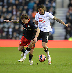 Reading's Simon Cox battles for the ball with Derby County's Cyrus Christie - Photo mandatory by-line: Alex James/JMP - Mobile: 07966 386802 - 14/02/2015 - SPORT - Football - Derby  - ipro stadium - Derby County v Reading - FA Cup - Fifth Round