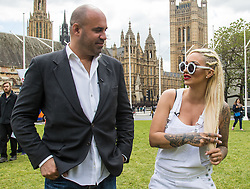 "Westminster, London, May 24th 2016. Animal rights protesters from ""Boycott Dogs4Us"" protest outside Parliament against puppy farming and third party puppy selling as the Environment, Food and Rural Affairs Sub-Committee are investigating the sale of dogs as part of their animal welfare inquiry. PICTURED: TV Vet Marc Abraham and Jodie Marsh."