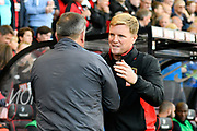 AFC Bournemouth manager Eddie Howe greets Leicester City manager Craig Shakespeare before the Premier League match between Bournemouth and Leicester City at the Vitality Stadium, Bournemouth, England on 30 September 2017. Photo by Graham Hunt.
