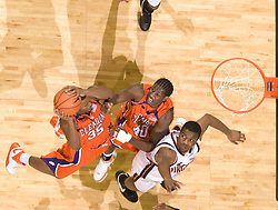 Clemson forward/center Trevor Booker (35) grabs a rebound against Virginia.  The Virginia Cavaliers men's basketball team fell the Clemson Tigers at 82-51 the John Paul Jones Arena in Charlottesville, VA on February 7, 2008.