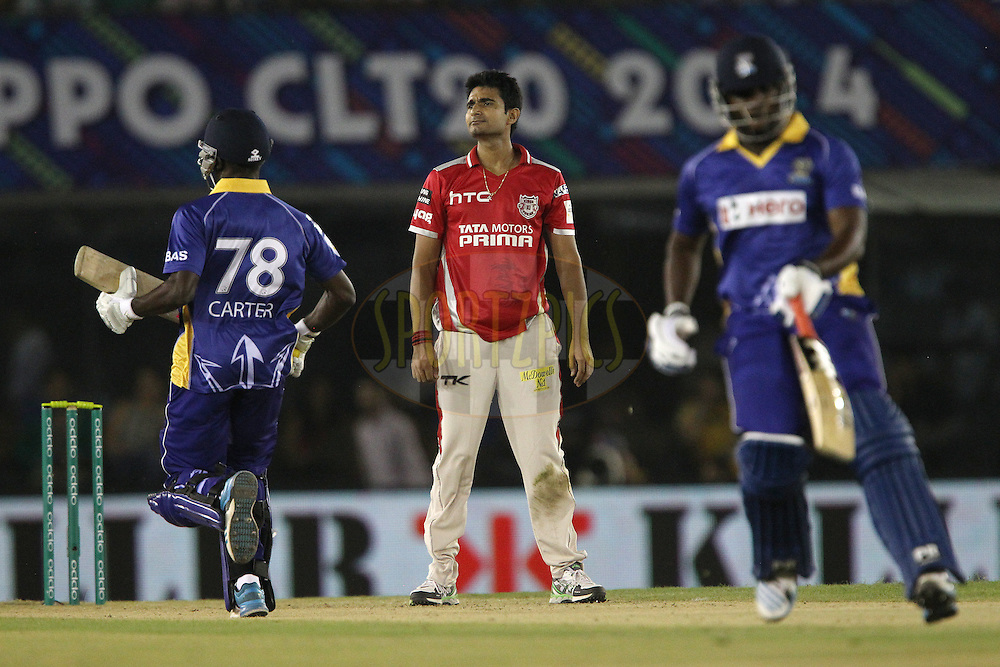 Karanveer SINGH of the Kings XI Punjab  during match 5 of the Oppo Champions League Twenty20 between the Kings XI Punjab and the Barbados Tridents held at the Punjab Cricket Association Stadium, Mohali, India on the 20th September 2014<br /> <br /> Photo by:  Ron Gaunt / Sportzpics/ CLT20<br /> <br /> <br /> Image use is subject to the terms and conditions as laid out by the BCCI/ CLT20.  The terms and conditions can be downloaded here:<br /> <br /> http://sportzpics.photoshelter.com/gallery/CLT20-Image-Terms-and-Conditions-2014/G0000IfNJn535VPU/C0000QhhKadWcjYs