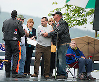 Mark Decoteau welcomes two gold star families on stage along with Bob Jones, Governor Maggie Hassan, Senator Jeanie Forrester and Wesley Wells (seated).  Decoteau's son Army Spc. Marc Paul Decoteau was killed in Afghanistan on January 29th, 2010.  Mark Decoteau spoke to the crowd gathered at Hesky Park following the Freedom Ride Thursday evening.  (Karen Bobotas/for the Laconia Daily Sun)