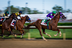 California Chrome with Victor Espinoza up pulls away at the top of the stretch to win the 140th running of the Kentucky Derby at Churchill Downs May 3, 2014. Photo by Jonathan Palmer
