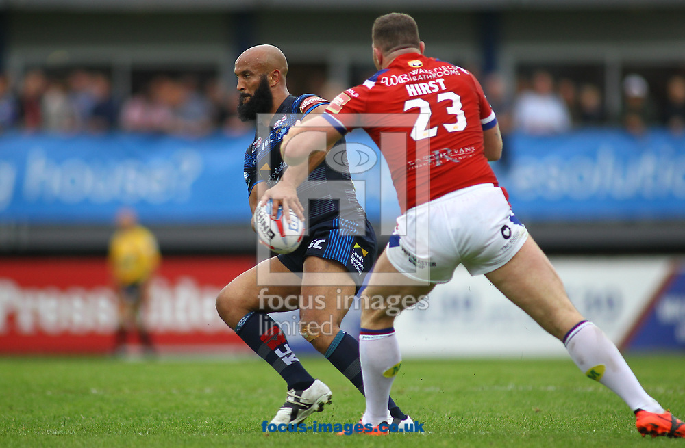 Keegan Hirst (R) of Wakefield Trinity tackles Jamie Jones-Buchanan (L) of Leeds Rhinos during the Betfred Super League match at the Beaumont Legal Stadium, Belle Vue, Wakefield<br /> Picture by Stephen Gaunt/Focus Images Ltd +447904 833202<br /> 10/06/2017