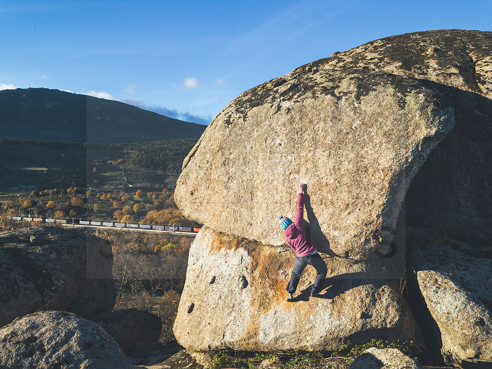 manuel prats Rab climbing athlete Lara Molina enjoying a boulder winter afternoon in Zarzalejo, Spain