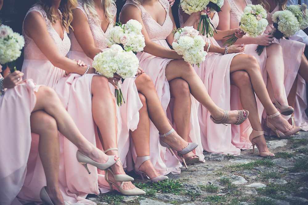 bridesmaids in soft pink with white bouquets