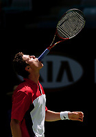 MELBOURNE, AUSTRALIA - JANUARY 23: Marat Safin of Russia swallows his racket during day five of the Australian Open January 23, 2004 in Melbourne, Australia. (Photo by Lars Mueller/Sportsbeat) *** Local Caption *** -