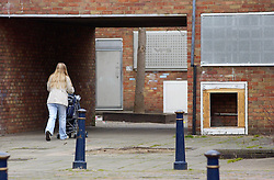 © Licensed to London News Pictures 04/05/2004.A mother walks through a passage way in Craylands estate, an impoverished council estate in Basildon, Essex..Basildon, UK.Photo credit: Anna Branthwaite