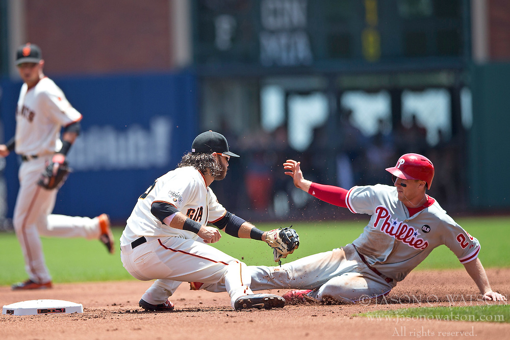 SAN FRANCISCO, CA - JULY 12:  Cody Asche #25 of the Philadelphia Phillies is tagged out attempting to steal second base by Brandon Crawford #35 of the San Francisco Giants during the second inning at AT&T Park on July 12, 2015 in San Francisco, California.  (Photo by Jason O. Watson/Getty Images) *** Local Caption *** Cody Asche; Brandon Crawford