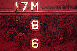 Stock photo of a close up of lettering painted onto an oil tanker