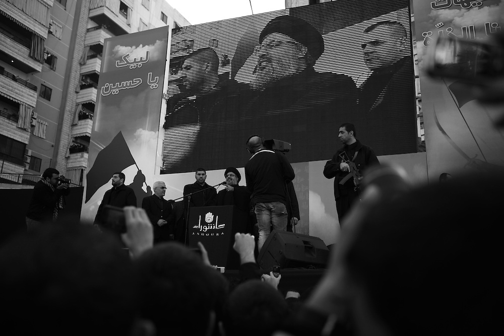 Nasrallah said the crowd were 'companions' of Imam Hussein, on a stage which read: 'We are ready for you, oh Hussein'.