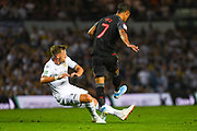 Leeds United defender Barry Douglas (3) tackles Stoke City midfielder Thomas Ince (7) during the EFL Cup match between Leeds United and Stoke City at Elland Road, Leeds, England on 27 August 2019.