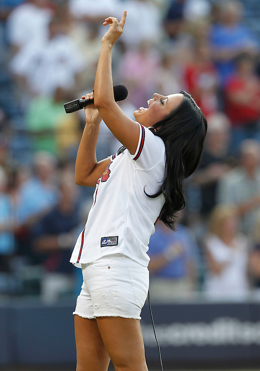 ATLANTA - AUGUST 7:  Singer Sara Evans sings the national anthem before the game between the Atlanta Braves and the San Francisco Giants at Turner Field on August 7, 2010 in Atlanta, Georgia.  The Braves beat the Giants 3-0.  (Photo by Mike Zarrilli/Getty Images)
