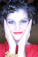 smiling young woman with hands on her face