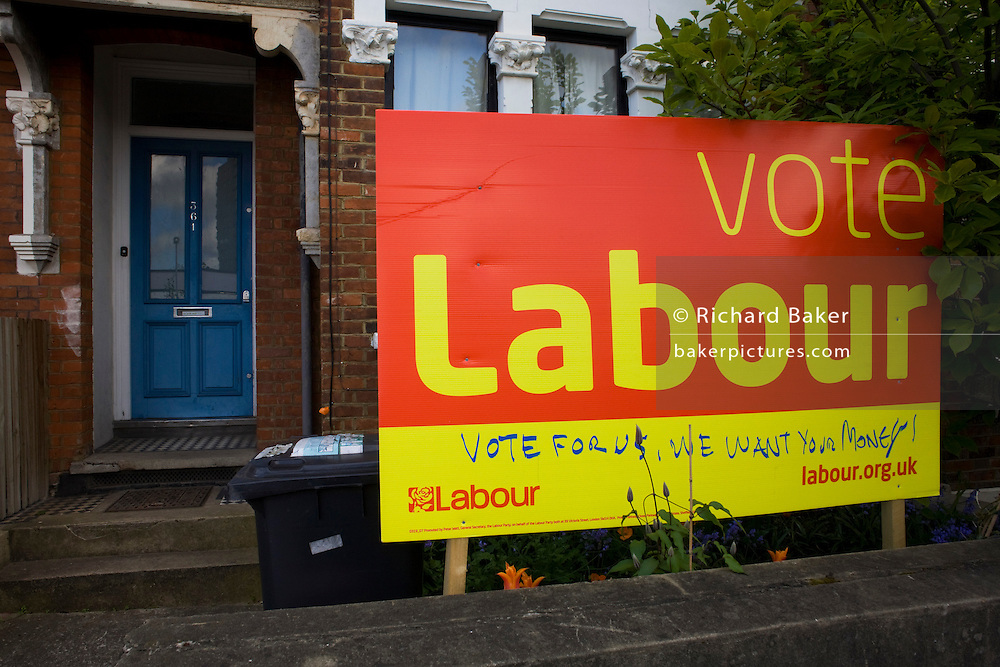 A defaced Labout Party poster is displayed in a fronty garden in Herne Hill, South London. Seat of Tessa Jowell MP.