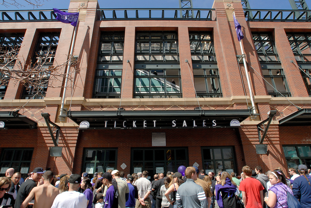 A crowd gathers near the ticket windows at Coors Field on the Colorado Rockies opening day.