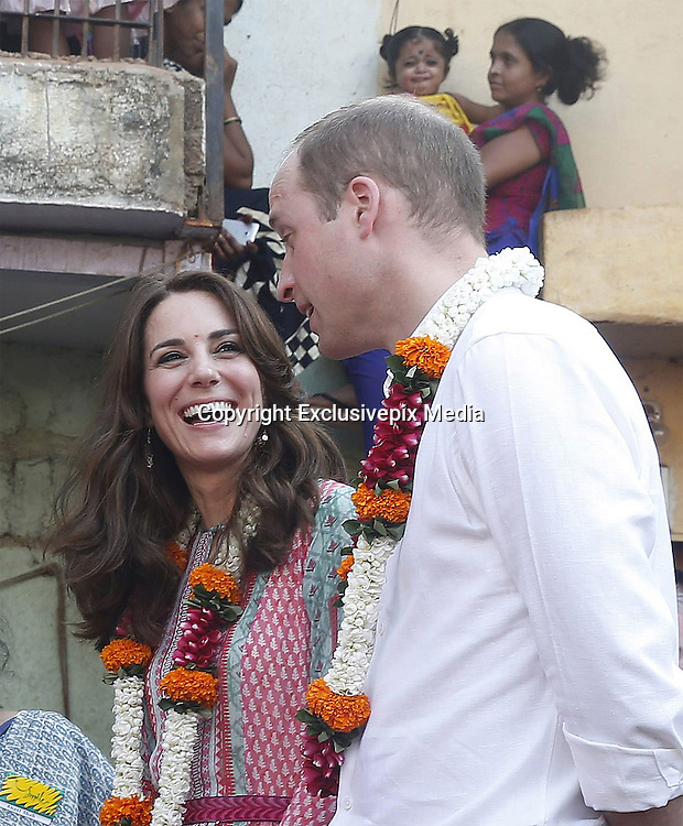 April 10, 2016 - Mumbai, INDIA - <br /> <br /> Britain's Prince William, talks to the people as his wife Kate, the Duchess of Cambridge, laughs during their visit to a slum in Mumbai, India, Sunday, April 10, 2016. The royal couple began their weeklong visit to India and Bhutan, by laying a wreath at a memorial Sunday at Mumbai iconic Taj Mahal Palace hotel, where 31 victims of the 2008 Mumbai terrorist attacks were killed. <br /> ©Exclusivepix Media