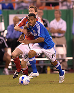 July 1, 2007 - Kansas City, MO..Kansas City Wizards forward Scott Sealy #19 dribbles up field against pressure from Toronto FC defender Andy Welsh #7 in the second half at Arrowhead Stadium in Kansas City, Missouri on July 1, 2007...MLS:  The Toronto FC and Wizards ended in a 1-1 tie.   .Photo by Peter G. Aiken / Cal Sport Media